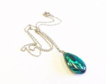 Vintage, Art Deco, emerald foil drop pendant on silver chain.