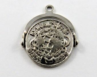 Mechanical Spinner or Flipper New York World's Fair 1964-1965 Sterling Silver Charm of Pendant.