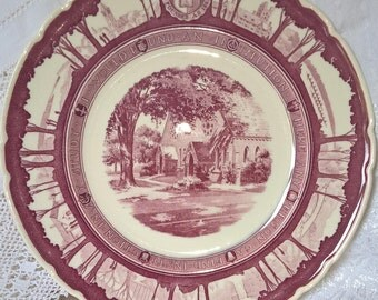 Cornell University commemorative Wedgwood wine colour transfer ware plate, showing Sage Chapel in the centre.  Beautiful Art Deco border.