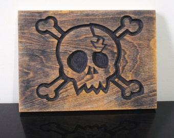 skull and cross bones carving