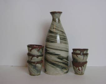 Black and White High Fire Stoneware Sake Set with Red Trim, Bottle and 6 Cups