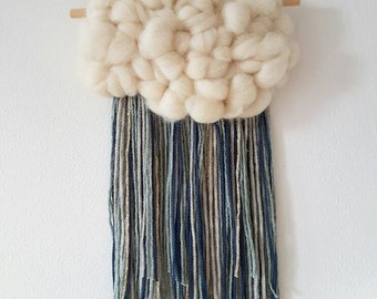 Fluffy cloud Woven Wall Hanging, nursery decor. Ivory roving and fringe of blue and grey and a little gold