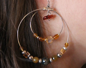 Hoop earrings with crystals and stones in shades of amber
