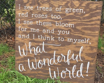 "Hand-lettered wood sign: ""What a Wonderful World"""