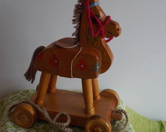 A Price reduction... Wooden pull along Horse on Wheels.