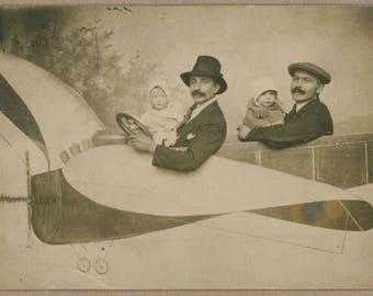Papas Flying High With Precious Cargo | 1920's Photo Postcard Portrait | Gentlemen In Dapper Caps & Wee Babes In Bonnets | Souvenir RPPC |