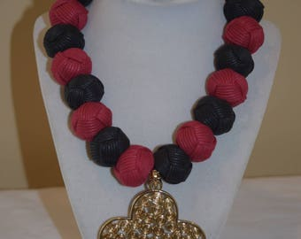 Black and Red Thread Beaded Set with Brass Pendant
