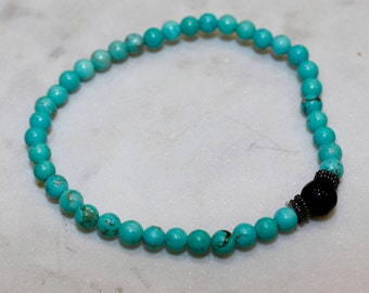 Beaded turquoise bracelet with black accent bead