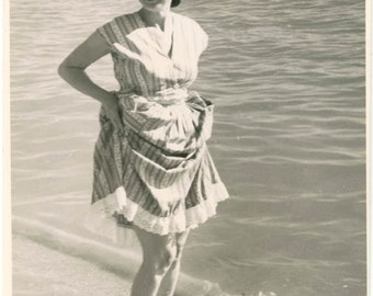 vintage photo 1940 Pretty Lady Lifts Ruffle SKirt up Legs WAdes in Ocean