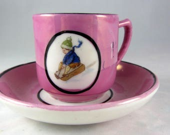 Vintage Pink Lustreware Child's Teacup/Saucer Featuring Child on Sled Possibly Japan Child Collectible Holiday Collectible