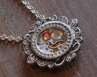 Steampunk Jewelry - Pendant - Watch movement and volcano crystal