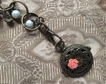 Locket Necklace Pocket Watch case Steampunk Industrial Gears Pearls and Brass with a Pink Rose