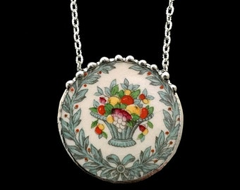 Edwardian broken china jewelry necklace laurel wreath with bow and fruit basket made from antique broken china. recycled china