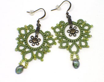 "Green lace earrings with green drop bead and bronze flower centers. 2"" dangle earring. Bronze fishhook ear wires. Greenery fun for Spring!"