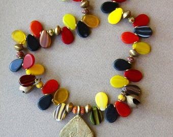 African Wedding Bead Necklace Fun Colorful Red Yellow Green Black Glass Drops w African Brass House Pendant Ethnic Boho Jewelry