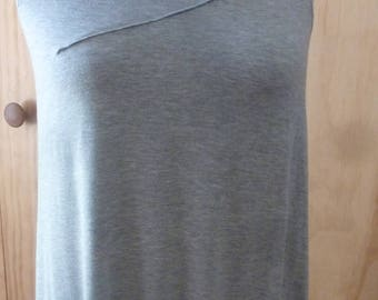 Light gray sleeveless top with front stitch detail and drape back detail
