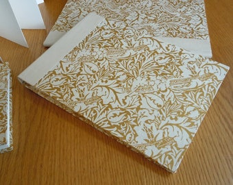 Large White and Gold Ribbons and Leaves in a Blank Guest Book or Album