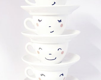 4  hand-printed happy faces cups