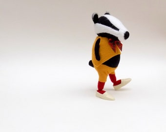 Woollen Badger  -  Handmade plush badger wearing red woolly tights and yellow felt suit with tartan bow.