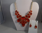Bib Choker Necklace with Red Crystal Like Beads on a Gold Tone Chain with Matching Earrings
