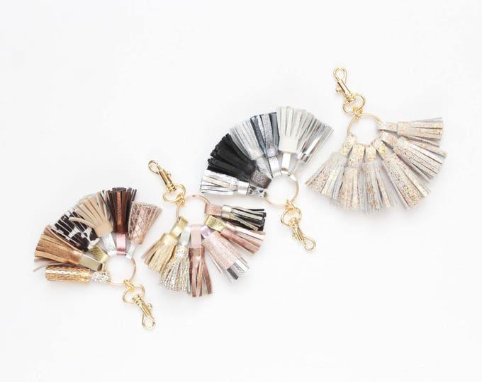Natural leather key chain. Genuine leather keychain. Mini tassel keychain. Metal key fob. Handmade tassels. Bag charm. Metallic silver gold.