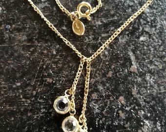 Vintage Avon gold colour necklace, with round bezel set cz gemstones, in a cluster.