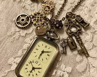 Vintage, Oblong, Double Watch Pendant.  Perfect For Traveling. Able To Set For Two Time Zones.  Antique Bronze Tone.