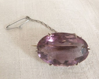 A gorgeous Silver metal and Amethyst Brooch