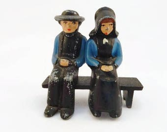Vintage Amish Doll Figurines on Bench Cast Iron Hand Painted Sitting on Bench