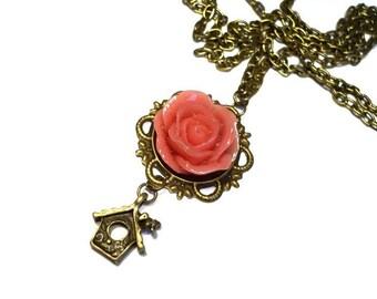 Rose with bird feeder chain
