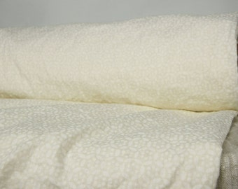 Thin pure 100% linen fabric 135gsm. Small white geometrical pattern on ivory background. Washed-softened, dense, for light clothes.