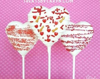 Valentine heart lollipops. heart lollipops. valentine's day treats. valentine's lollipops. kids treats. chocolate. chocolate lollipops.
