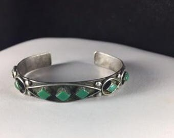 Southwestern Turquoise Cuff Bracelet with Diamond Shaped Green Turquoise Stones Adorned with Sterling Silver Details