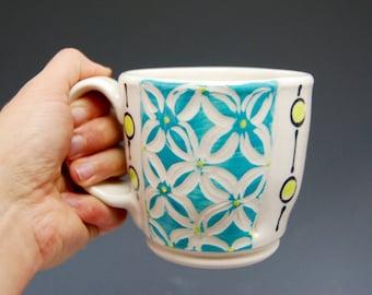 Turquoise floral print and chartreuse circles ceramic porcelain mug