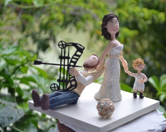 Bride dragging groom and child. Handmade. Fully customizable. Wedding cake topper or centerpiece. Hunter groom.