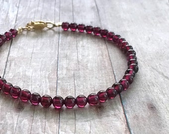 Gold Garnet Bracelet / Red Gemstone Bracelet / 14 K Gold Filled Clasp / January Birthstone Jewelry