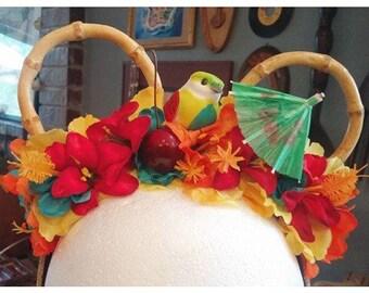 Disney Enchanted Tiki Room Mickey ears with bamboo ears, bird, cherry and tropical drink umbrella