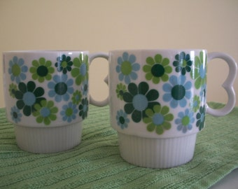 Mugs with blue and green daisies, set of 2, stackable, 1970's
