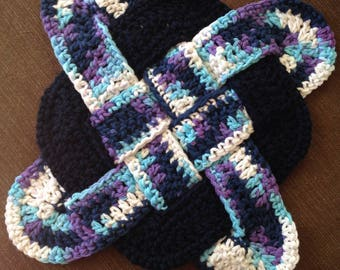 Trivet, crocheted hotpad in navy blue, white, and purple