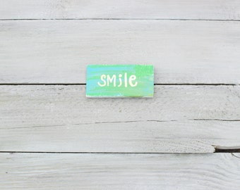 Mini green and blue Smile wooden sign