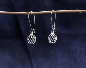 Earring with silver ball