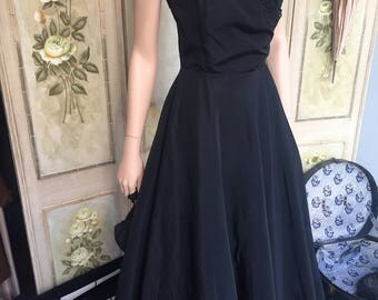 original 1950s taffeta dress by Wolgar. Guide size 10 - 12