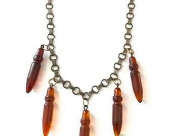 Vintage Carved Bakelite Bullet Necklace