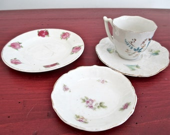 """Assortment of Farmhouse Style China: Small Saucer 3"""" Made in Austria   Larger Saucer 4 1/4""""  Scalloped Saucer 3 3/4"""" with Mismatched Cup"""