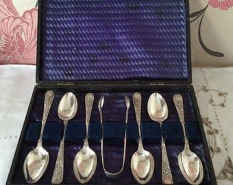 Boxed Set Six Ornate Silver Plate, EPNS, Teaspoons, plus Matching Sugar Tongs.  Made in England c. 1930s.