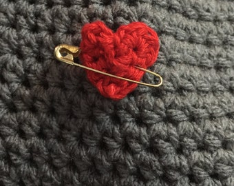 Gold pin with small crocheted heart