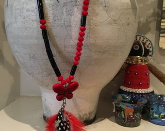 Howlite , glass beads and feathers! Rich red and black necklace