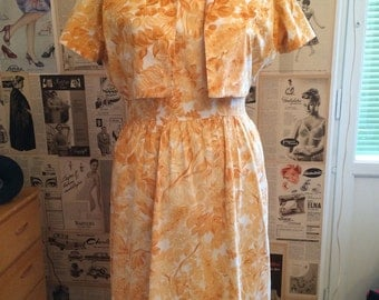 Vintage 1950's Peach colored rose printed, summer dress with matching bolero. Size L