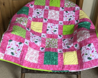 Flamingo Road . Very brightly colored, beautiful handquilted crib size.