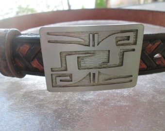 """Unique hand tooled 2 tone brown leather woven belt w/ abstract Native American vibe nickel or pewter buckle. Initialed JH by artist. 33-36"""""""